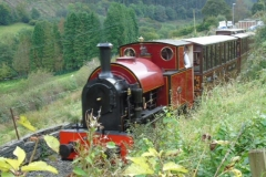A service train steams up Maes-y-Llan bank towards Corris.....