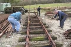"""Sunday, 24.4.2016. At the farm, Richard and Ade attempt """"synchronised bonking"""" to remove sleepers from track panels, while in the background, Jack removes baseplates and spikes from the rails."""