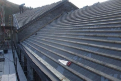 At Corris, finish battening of the Coach House & Parcels Office roof is almost complete in a bitterly cold East wind …