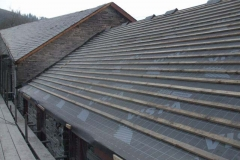 Thursday, 22.2.2018. The rear of the Harness Room and Hay Loft roof has been stripped of old slates, defective timber replaced, and the whole roof covered by new felt and battened ready for slating.