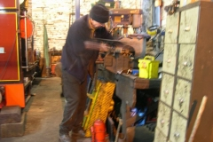Tuesday, 26.1.16. Chris makes brackets for the Carriage Shed …