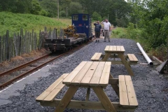 In the evening, two picnic tables have been delivered and assembled, while Andrew and Patrick have just finished disturbing the neighbours, tamping track in Corris.