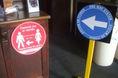 """Meanwhile, """"Covid-19"""" temporary signage has been delivered and fixed in Corris and Maespoeth."""