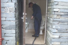 Tuesday, 25.5.2021. Richard leads the way in cleaning our toilets ready to receive visitors again after over 18 months without them!