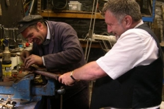 … after Trefor has taken the opportunity to splash rusty WD 40 on to Graeme's smart uniform inside the Engine Shed!