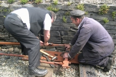 In between trains, Graeme (Guard) and Trefor (Driver) dismantle some of the point rodding in Corris for re-use at Maespoeth …