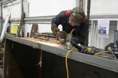 … before grinding down previous welds to a smooth finish.