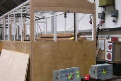 By mid-afternoon, more panelling has been fitted to one end of carriage No. 23 …