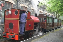 The last Up train of the day – with steamy carriages – departs Maespoeth during persistent rain …