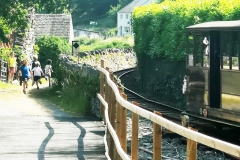 """The Corris Railway partakes in the annual """"Race the Train"""" in conjunction with Ysgol Corris. The youngsters seen here (in the distance!) took advantage of an early lead to make sure they finished before the train."""