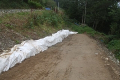 ... and covering it with geotextile as material is progressively tipped, tracked and rolled against it.
