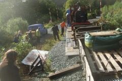 A ramp is soon set up (like a well-oiled machine!) and barrier waggons shunted down ...
