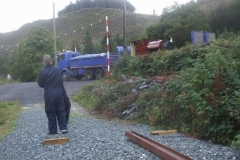 ... just as a passing lorry pulls in with a steam locomotive in tow!