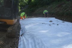 … to ensure there is an overlap with the next layer of geotextile.