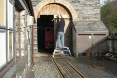… while Patrick brings the cladding timber on the Engine Shed doors flush with the face.