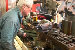 Meanwhile, Bob has set the lathe to turn another carriage axlebox, and by way of variety, mills a lock nut slightly narrower for Trefor …