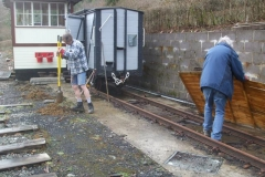 Meanwhile outside, Tony is digging holes for posts to support the roof of a waggon shelter, and Richard tidies up.