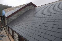 In Corris, the stable block roof is all but finished and the fresh pointing has been covered to protect it from rain and frost.