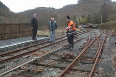 … while Phil and Charles converse with Ifor, oiling and greasing the point rodding runs and turnouts.
