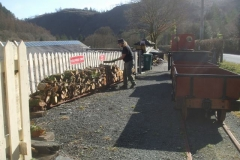 Sunday, 21.3.2021. Richard stacks logs from the heritage waggons ready for collection by road vehicle …