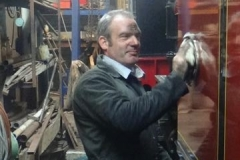 Sunday, 29.7.2018. Trefor is in his element, polishing No. 7 in the Engine Shed – with a black face!