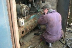 … with Graham Morris inspecting our compressor reservoir after having given No. 7's boiler a clean bill of health!