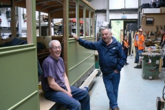 Andy and Ade who built our first  carriage in the East Midlands pose beside carriage 23 being built many  years later