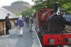 Passengers from a Holiday Fellowship group re-join the train, or check out the cab of No. 7 before departing Maespoeth.