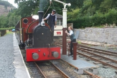 New recruit Gwion helps Jack to water the loco.