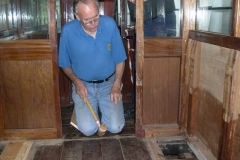 … while John fits floorboards inside carriage No. 20 …