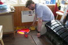 … while Richard has moved on to replacing batteries in one of our Stop signs – to be stored horizontally!