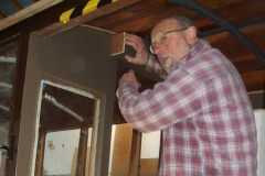 … with Charles, who is adding timber to the door pockets on Carriage No. 23.