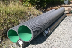 Saturday, 26.9.15. The culvert sections and rolls of geotextile have been moved ready for collection by road transport …