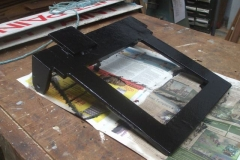 Meanwhile at Maespoeth, Tony has painted one of the tip-up seats for the Guard's compartment of carriage No. 24 in black …