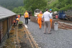 """A busy scene as the South Platform and 7.25"""" gauge track are thoroughly weeded …"""