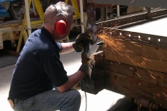 Ade cleans up welds and trims back old paint …