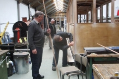 … while nearby, the body sides of carriage No. 23 are carefully measured …