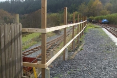 Opposite, the fence at the southern end of the South Platform is ready to receive its palings …