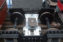 Adjacent, a partially assembled bogie awaits fitting of brakes and then placing under a carriage …