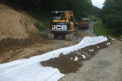 … and more geotextile rolled out ensuring an overlap, and material spread out again to hold it in position.