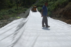 Friday, 31.7.2020. The geotextile is rolled out, with Dai anxious to be first on the newest attraction in Corris – but has forgotten his skis!