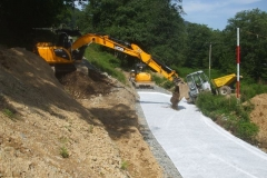 Granular material can then be gently positioned to stop the wind blowing the geotextile around …