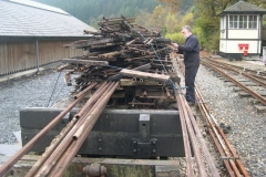 "Derek has loaded more 7.5"" gauge track panels on the bogie waggon, and then ropes them down …"