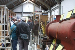 In the Carriage Shed, Bill is giving interested passengers a Shed Talk …