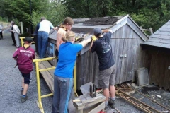 The scouts get to grips putting new slates on the shed roof...