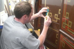 … Glenn Williams works on lining the final panel in carriage No. 22 ...