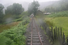 The first (Diesel) train approaches Maespoeth in the rain, with No. 7 …