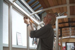 … while Peter continues fitting beads to the window surrounds in carriage No. 23.