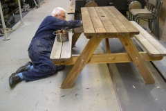 Phil relaxes after his seasonal feasting, while treating the picnic tables.