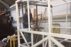 Carriage 24 south end being modified to become an observation saloon. Dave Coleman gets to grips fettling the welds before the painter starts. (2)